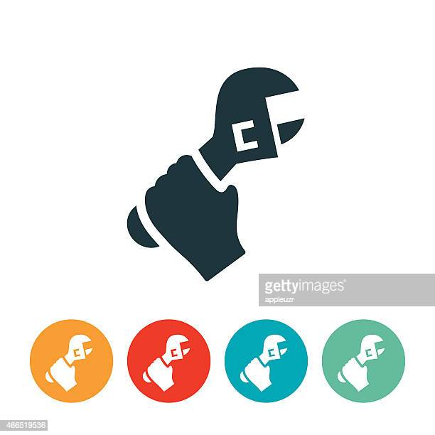hand hält ein schraubenschlüssel-symbol - schraubenschlüssel stock-grafiken, -clipart, -cartoons und -symbole
