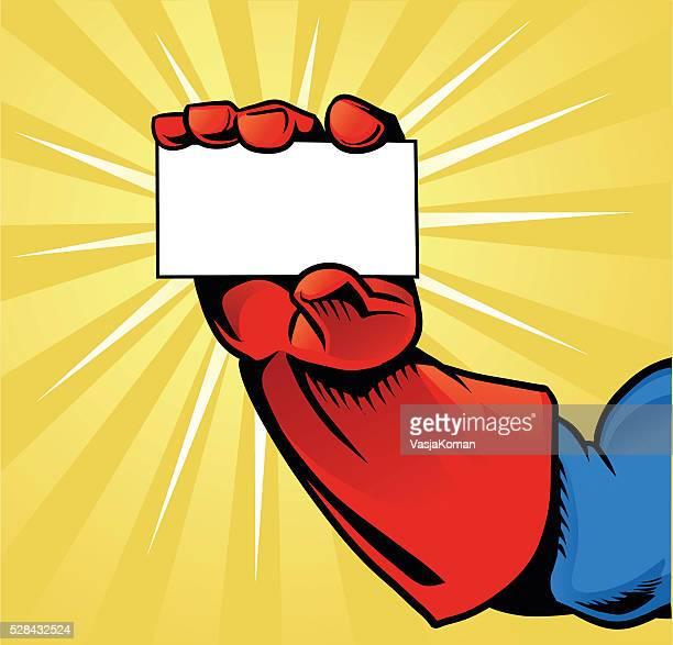 Main tenant la carte-super-héros