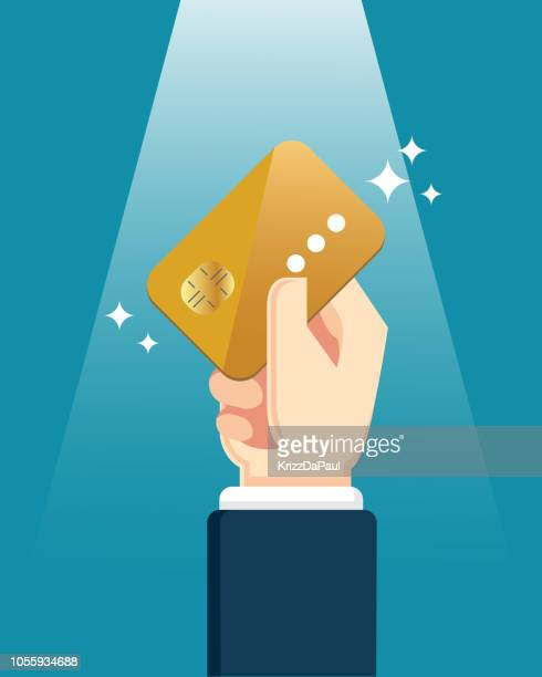 hand holding credit card - credit card stock illustrations