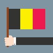 Hand holding flag Belgium