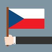 Hand holding flag Czech