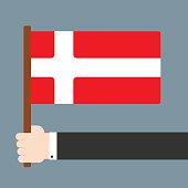 Hand holding flag Denmark