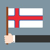Hand holding flag Faroe Islands