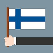 Hand holding flag Finland