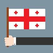 Hand holding flag Georgia