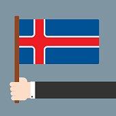 Hand holding flag Iceland