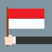 Hand holding flag Monaco
