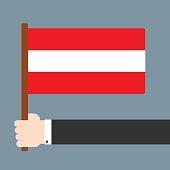 Hand holding flag Osterreich