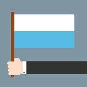 Hand holding flag San Marino