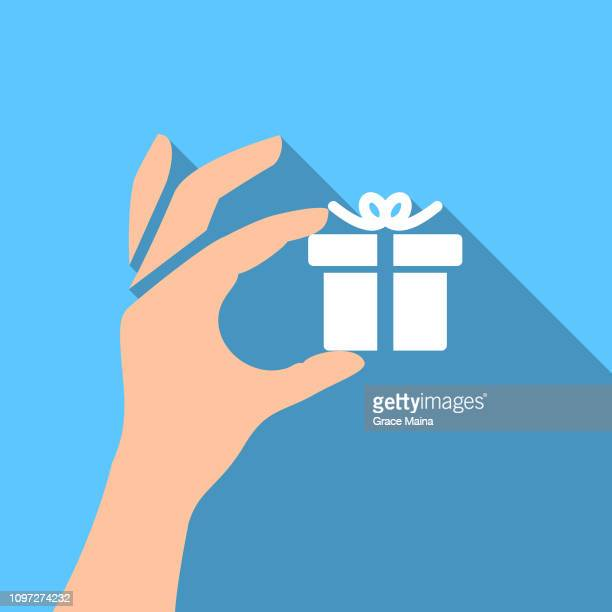 hand holding gift box - vector - forearm stock illustrations, clip art, cartoons, & icons