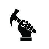 Hand holding hammer silhouette