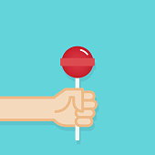 Hand holding lollipop candy. Vector illustration, flat design
