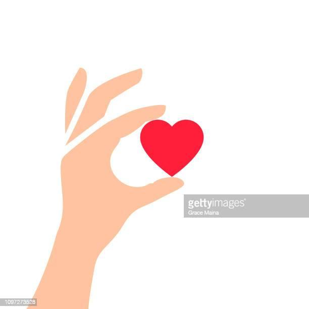 hand holding love heart symbol - vector - i love you stock illustrations