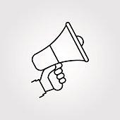 Hand holding megaphone