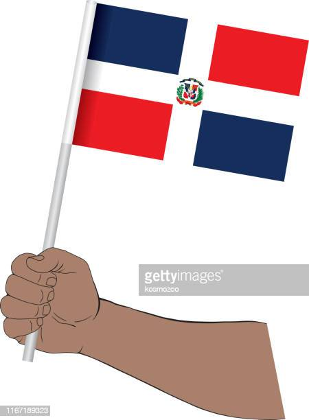 hand holding national flag of dominican republic - dominican republic flag stock illustrations