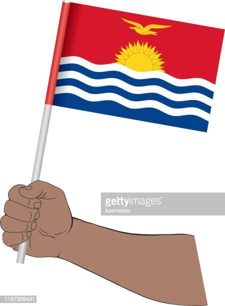 Hand holding national flag of Kiribati