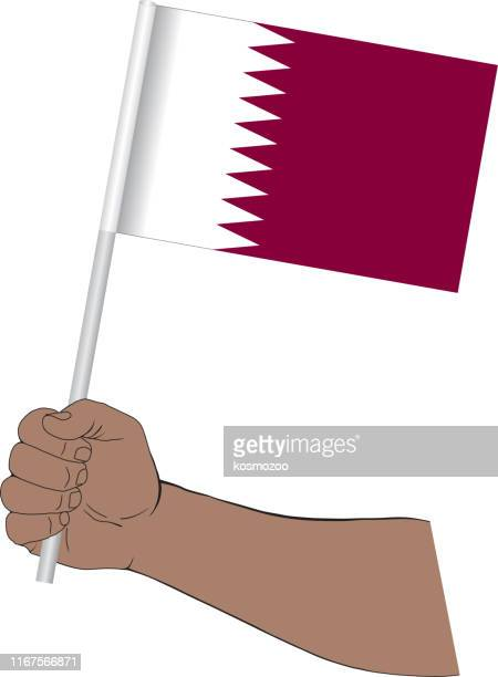 hand holding national flag of qatar - qatar stock illustrations, clip art, cartoons, & icons