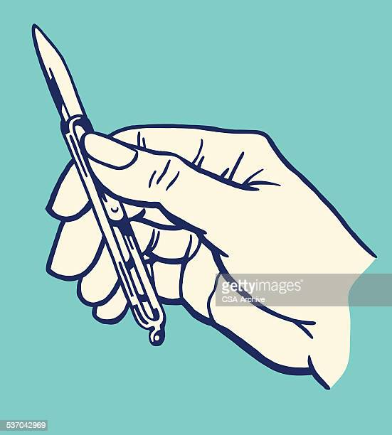 hand holding old x-acto knife - utility knife stock illustrations