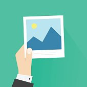 Hand holding photo frame vector illustration