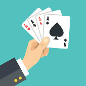 Hand holding playing cards. Four aces. Poker, gambling. Vector illustration