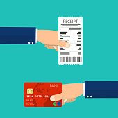 Hand holding receipt and hand holding credit card.