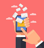 Hand holding smart phone and receiving online mail envelops. Electronic modern technology email communication concept