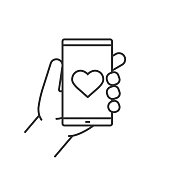 Hand holding smartphone icon