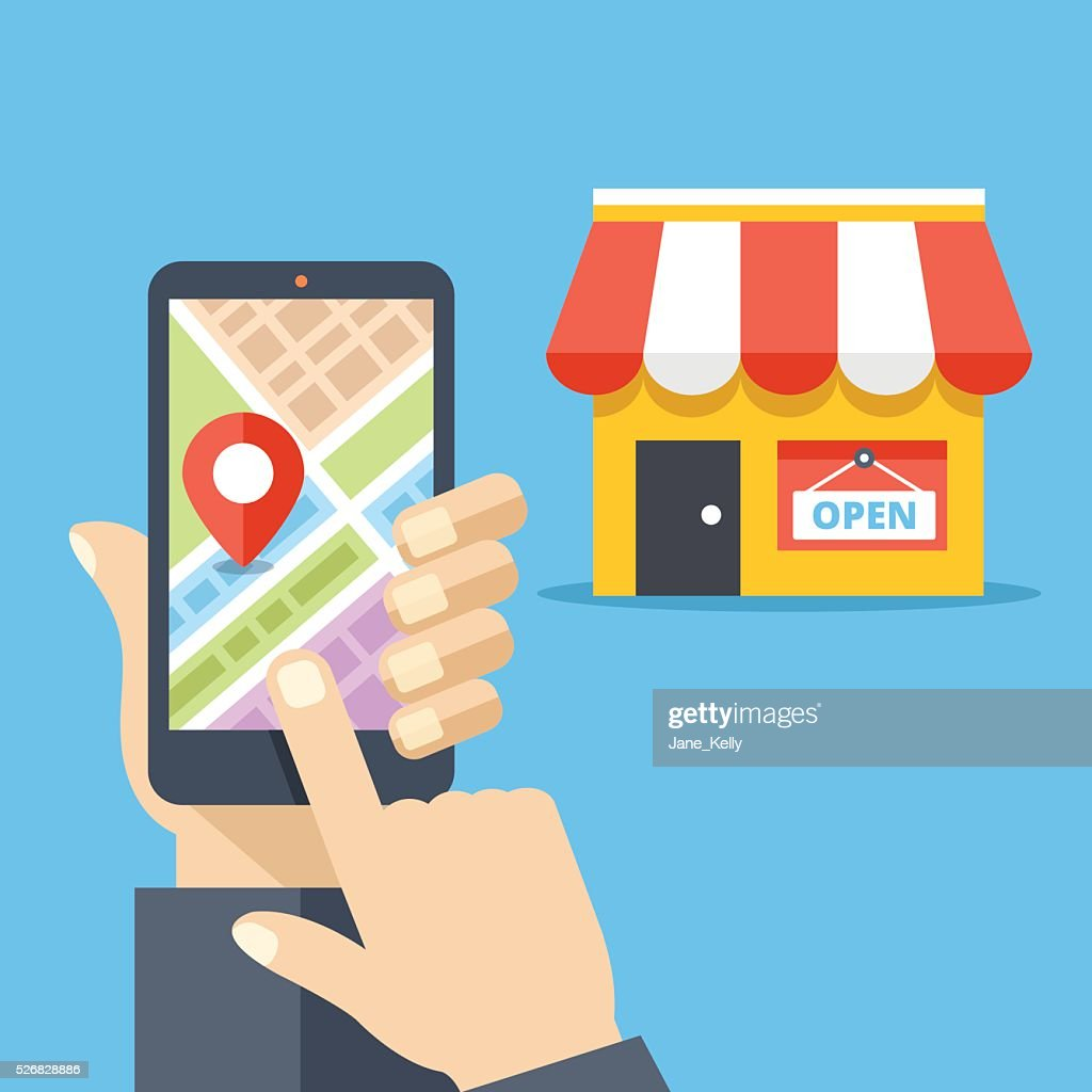 Hand holding smartphone with city map, store location on screen