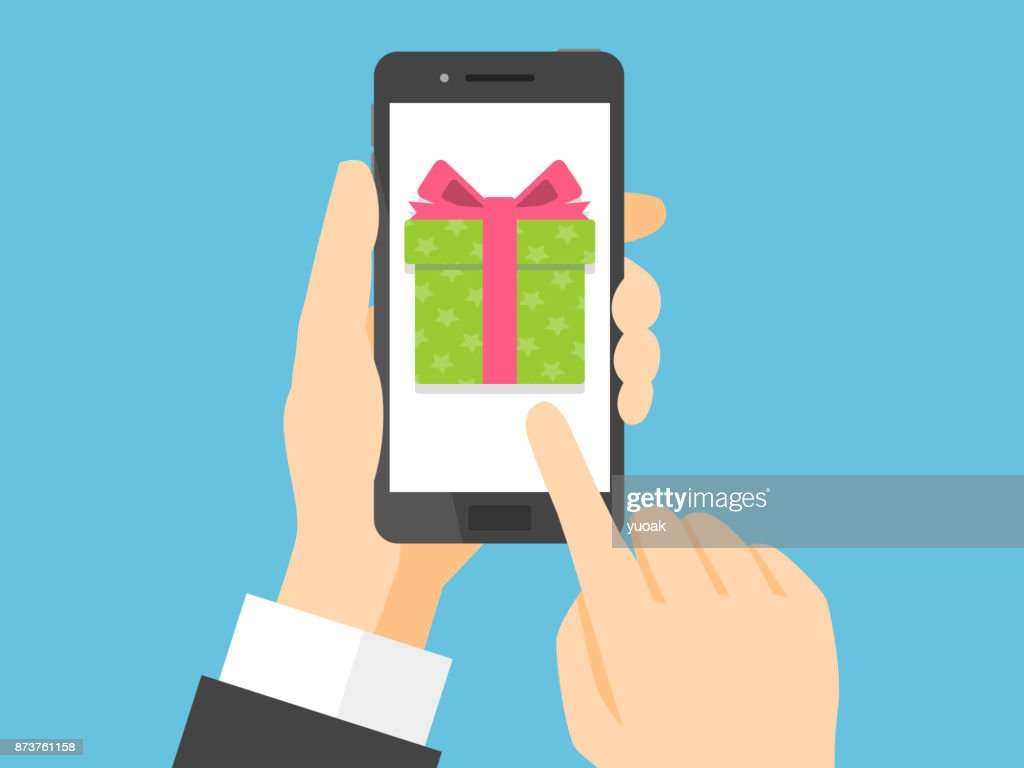 Hand holding smartphone with gift box on the screen