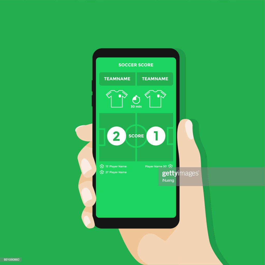 Hand holding smartphone with live score soccer or football application on screen.