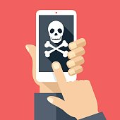 Hand holding smartphone with skull icon. Broken phone, malicious software
