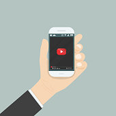 Hand holding smartphone with video player for website on the screen.Mobile applications isolated background.Mobile video player icon.Internet search engine browser window.Flat vector illustration