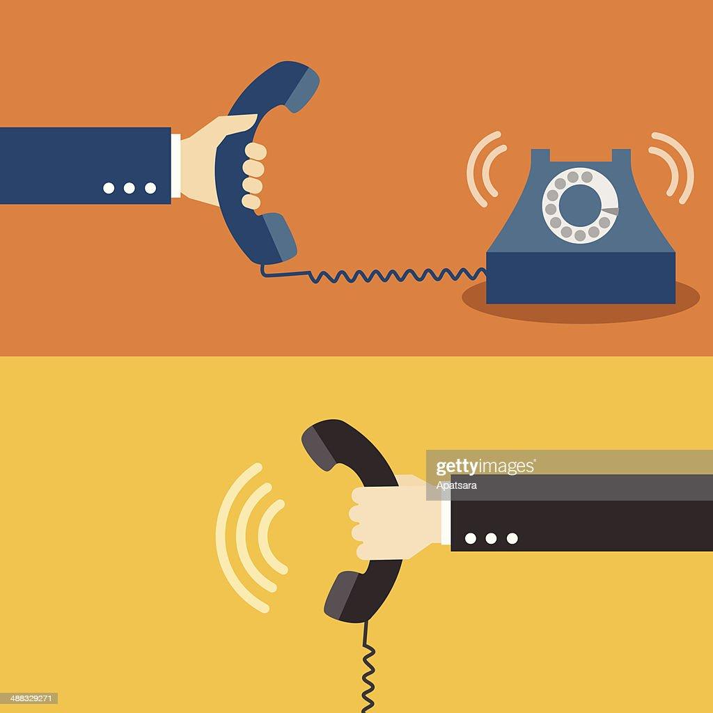 Hand holding telephone