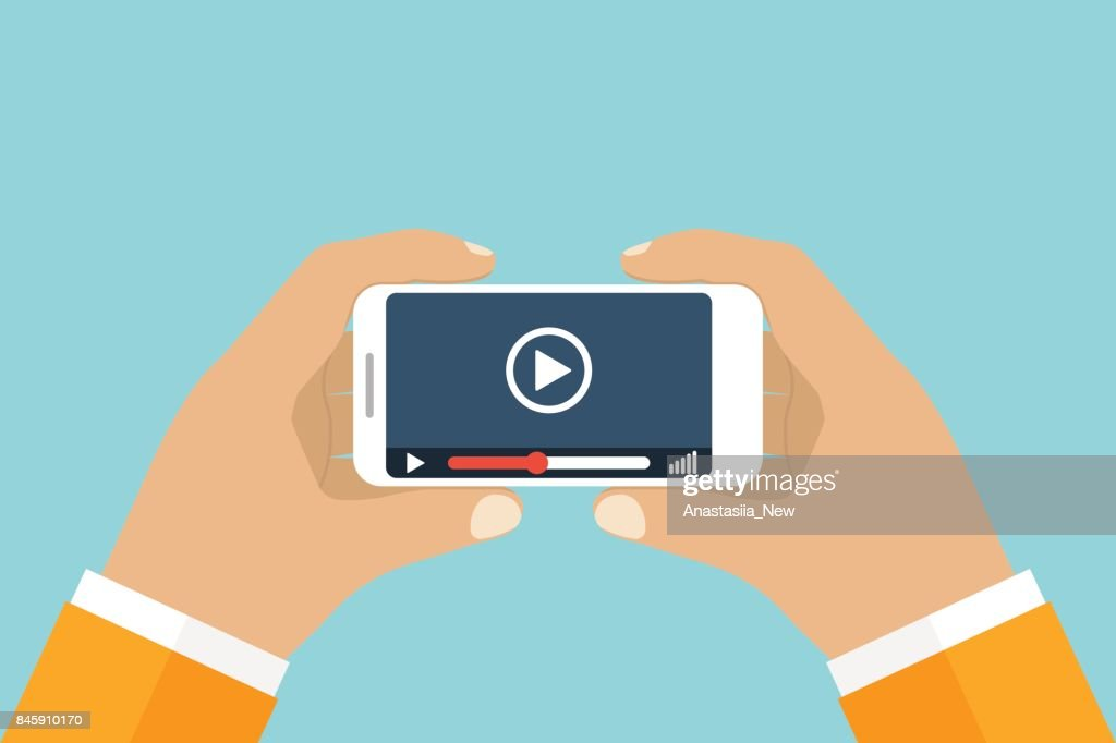 Hand holds smartphone. Video player application on your mobile phone screen.