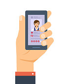 Hand holds the smartphone. Mobile applications. Social network, evaluation photo