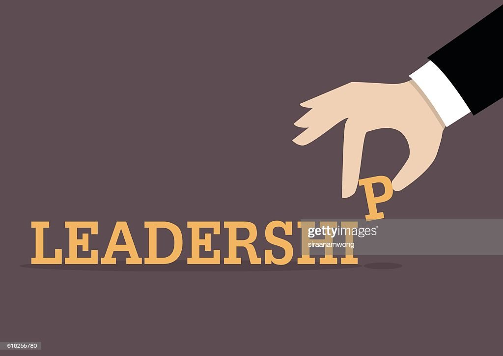 Hand inserts the last alphabet into leadership word : Arte vectorial