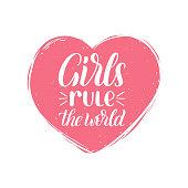 Hand lettering Girls Rule The World. Vector calligraphic illustration of feminist movement.Heart shape background.