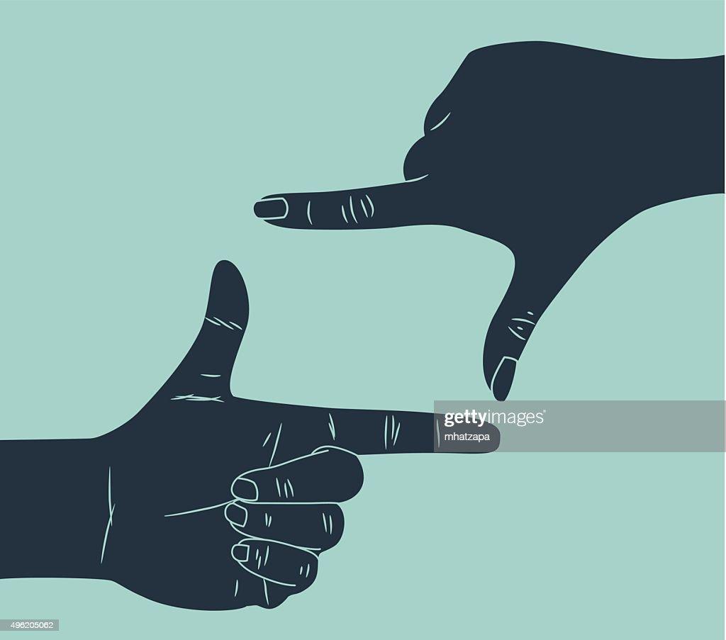 hand making finger frame gesture