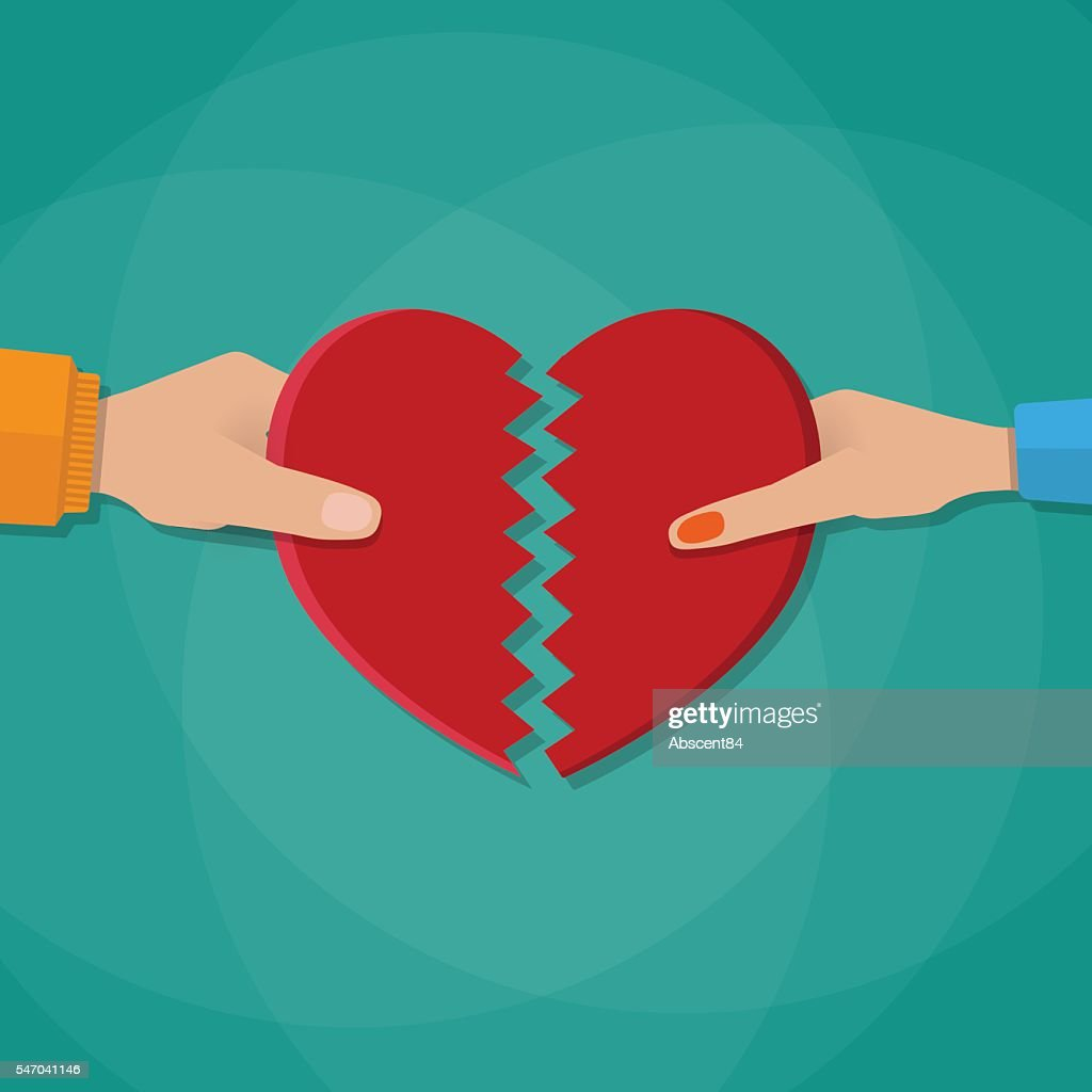Hand of a man and woman tearing apart heart