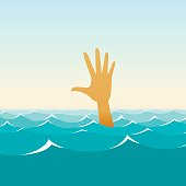 Hand of a sinking man in the midst of waves