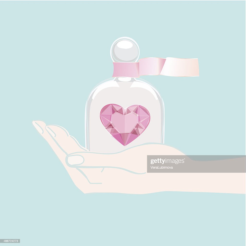 Hand offering a heart under a glass cover