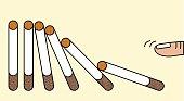 Hand pushing domino cigarettes