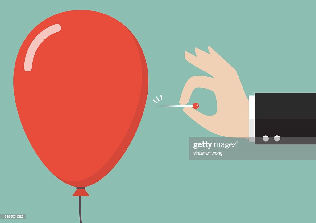 Hand pushing needle to pop the balloon