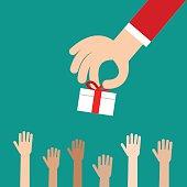 Hand putting gift box to many kids, Donation