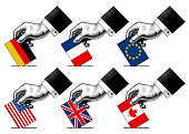 Hand putting voting paper with flags of USA, Canada, EU, Germany, France and Great Britain