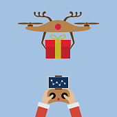 Hand Santa Claus with remote control