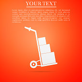 Hand truck and boxes icon isolated on orange background. Dolly symbol. Flat design. Vector Illustration