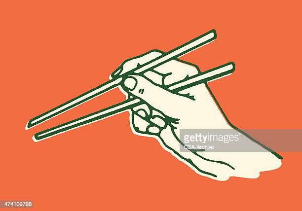 hand using chopsticks - chopsticks stock illustrations, clip art, cartoons, & icons