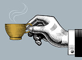 Hand with a coffee cup