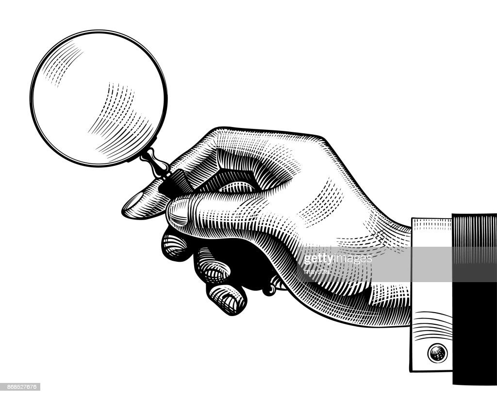 Hand with an old magnifying glass